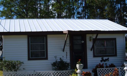 Roofing System Coating On Metal Roof Of Small Florida Home