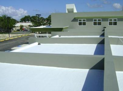 Roofing System Coating In Two Colors On Cement Roof.