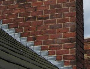 Metal wall step flashing used around chimney