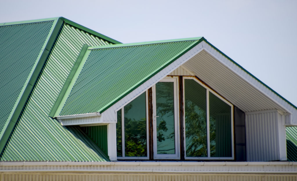 Corrugated Metal Roofing Panels in green coating installed.