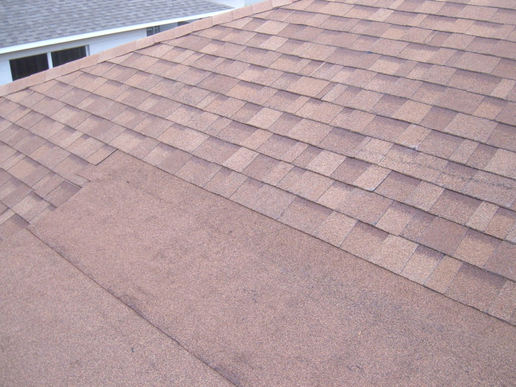 Flat asphalt granule roof.